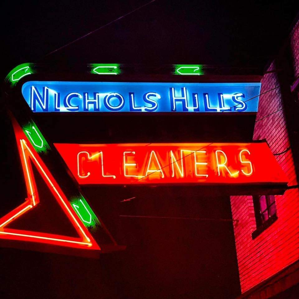 Neon Sign are on at of Nichols Hills Cleaners at night